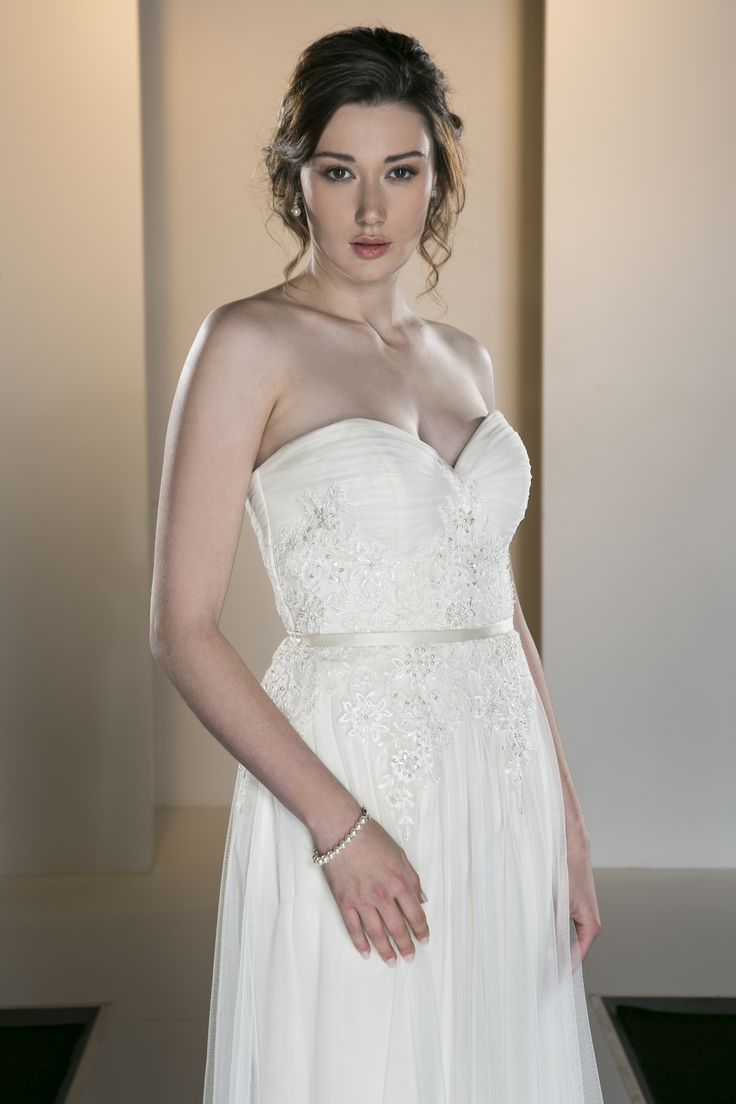 OCA 549T 'Madison' A tightly rouched bodice and full gathered soft tulle gown with an embroidered beaded waist detail.