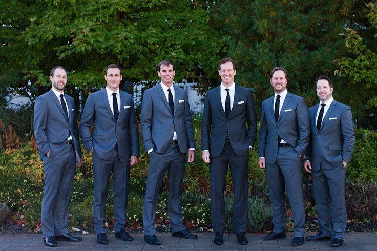 love this sharp look. Navy groom, gray groomsmen, white shirt, black tie