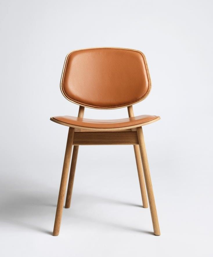 Pandora Chair designed by Danish furniture architect Carsten Buhl. Simple Nordic design and great Danish craftsmanship by manufacturer True North Designs. The chair is a simple, robust and very comfortable wooden chair. The frame is made from solid oak and the seat and back in plywood with an oak veneer finish. The chair is offered in oak/oil, oak/lacquer, painted oak and any combination thereof. Here upholstered seat and back. The Pandora Chair can be experienced at the Scandinavian…