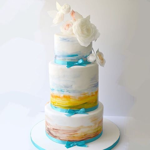 Inspired by the vivid colours of the Arizona sunset. Watercolor and waferpaper wedding cake. #weddings #weddingcake #bridal #watercolor #waferpaper #sunset #arizona #jerusalem #edibleart #lovesatinice #cakestagram #customcake #flowerstagram #flowers #painting #baking #bakeandshare #thebakefeed #kosher #sweet #makingjerusalemsweeter  @katiepavlich @magic_colours_inside @modernweddingmagazine #theknot @weddingbellsmag @heytherecupcake_