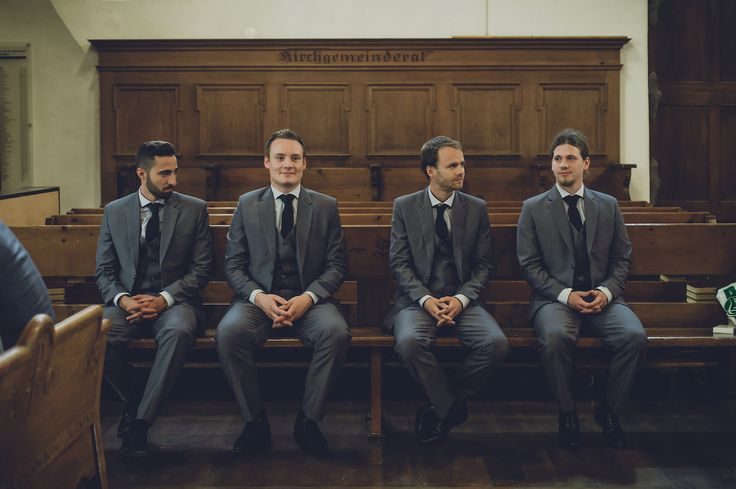 Groomsmen in grey waiting in the protestant church in Köniz, Bern, Switzerland. Photo by Monica Tarocco