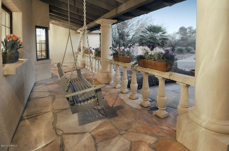 Mediterranean Patio with Fence, Flagstone - Arizona Buff, Pathway, Phat Tommy Weatherly Porch Swing, exterior stone floors
