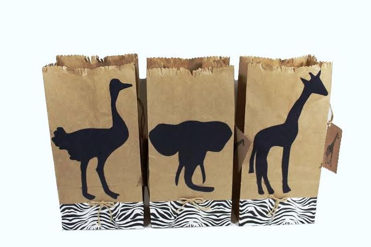 Handmade one of a kind favor bags They are perfect for your child special birthday Overview: 12 paper favor bags with tag. (4 elephants, 4 giraffes and 4 ostriches) Measuring: ( 5 inches wide X 3 inch