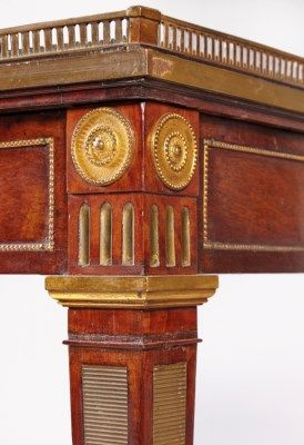 A GERMAN ORMOLU-MOUNTED AND BRASS-INLAID ACAJOU MOUCHETE (PLUM PUDDING MAHOGANY) WRITING-TABLE   ATTRIBUTED TO DAVID ROENTGEN, CIRCA 1785-90