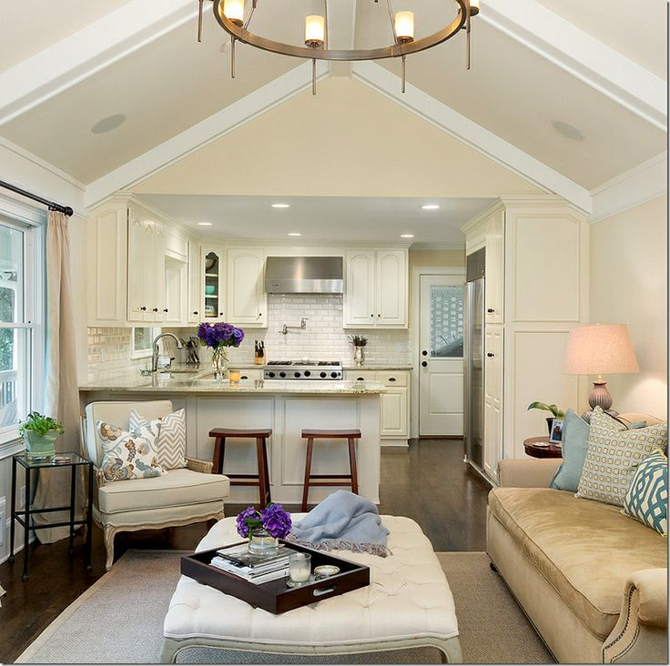 High ceiling arched living area perfectly frames the kitchen.