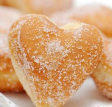 Healthy Baked Donut Hearts. These fluffy doughnuts are addictive--good thing they are healthy and only 104 calories each! | via @SparkPeople #food #Valentine #breakfast #treat