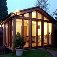 Garden Lodge, lit up at night, I love this one from Garden Lodges.