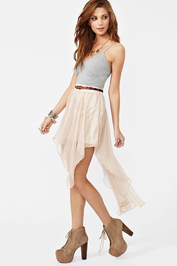 light gray tank with a skinny brown belt and a white skirt paired with nude suede heels