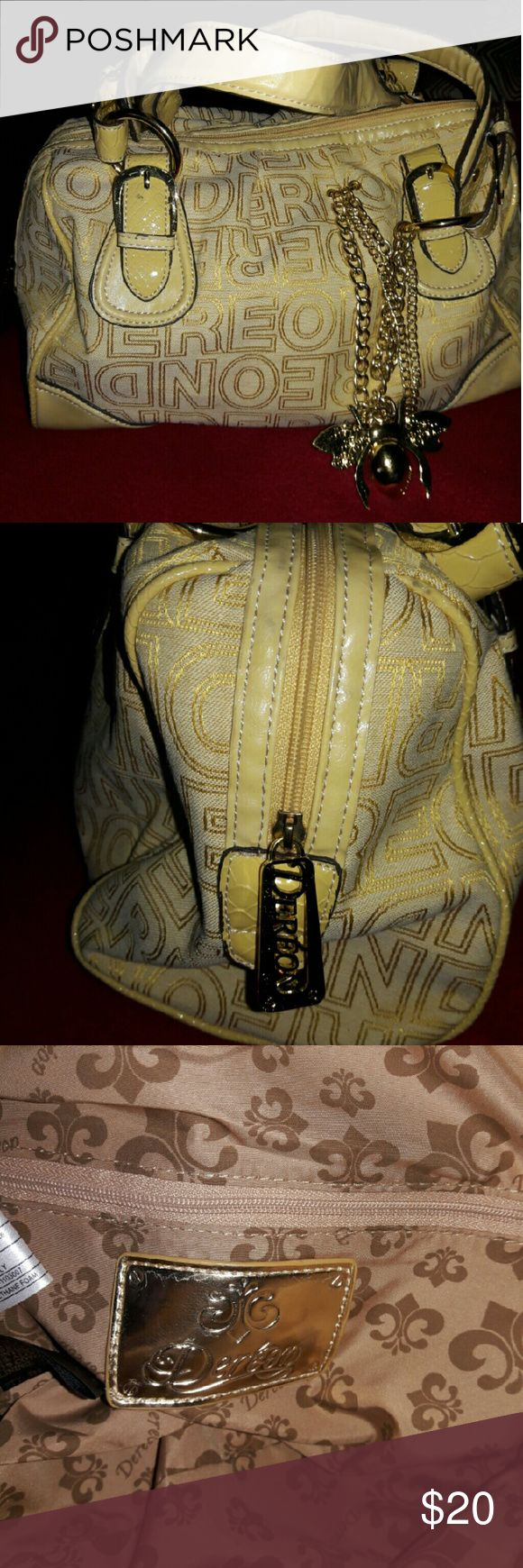 Cute DEREON purse Very cute purse with gold hard ware by DEREON Dereon Bags Satchels