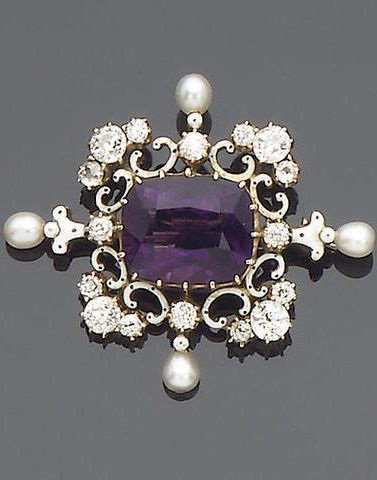 An amethyst, diamond, seed pearl and enamel brooch, circa 1900. Claw-set to the centre with a cushion-shaped amethyst, within a scrolling quatrefoil border decorated with black and white enamel, old brilliant and single-cut diamonds and four seed pearl finials, length 3.8cm.