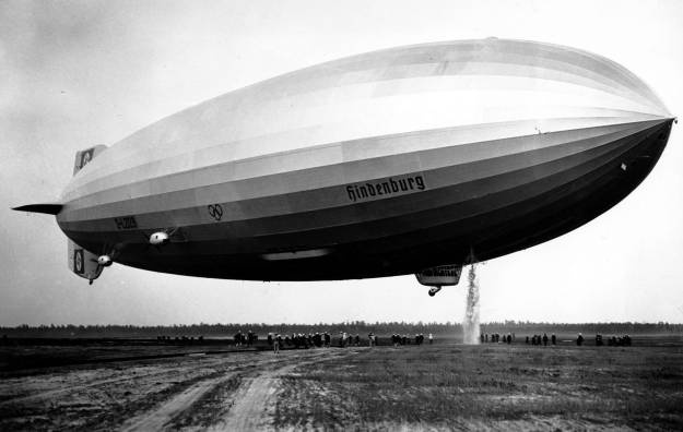 The Hindenburg dumps water to ensure a smoother landing in Lakehurst, New Jersey, on May 9, 1936. The airship made 17 round trips across the Atlantic Ocean in 1936, transporting 2,600 passengers in comfort at speeds up to 135 km / h (85 mph). The Zeppelin Company began constructing the Hindenburg in 1931, several years before Adolf Hitler's appointment as German Chancellor. For the 14 months it operated, the airship flew under the newly-changed German national flag, the swastika flag of th