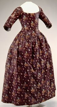 Chintz round gown - 1775-1790 - This round gown is made of a glazed printed cotton which was popular for gowns. It would have been available for purchase once the Revolutionary War ended and fabric was once again being imported from Britain. Round gowns became popular during the last quarter of the 18th century. Most gowns in the 18th century had the skirts split down the front, allowing the petticoat to show. Round gowns did not have a split down the front. zoom icon