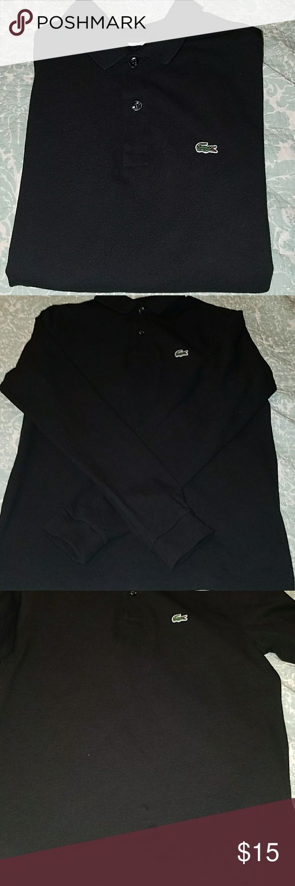 Lacoste long sleeve black polo shirt Boys long sleeve Lacoste polo shirt. GENTLY USED. Only worn twice for special occasions.  No holes or tears. There are a few small spots on bottom front part of shirt. They are actually a darker black color so shirt is barely seen when worn. See pictures. This shirt was recently purchased and it's still for sale for $50 in lacoste store. Lacoste Shirts & Tops Polos