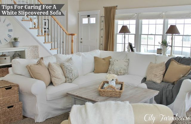 How to keep your white slipcovered Sofa pretty & clean with kids & pets. Tips at City Farmhouse.