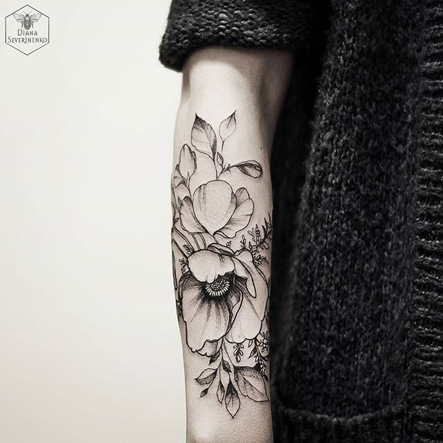 "I really like how there are other ""sprigs"" of what looks like a plant similar to Juniper barely peeking out from behind the big blooms on this tattoo(towards the top right). I would love the juniper and lavender in my design to be similar (complimentary, but not the main focus)."
