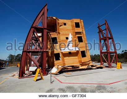 A four-story wood frame building is tested under the conditions of a number of historical earthquake data using - Stock Photo