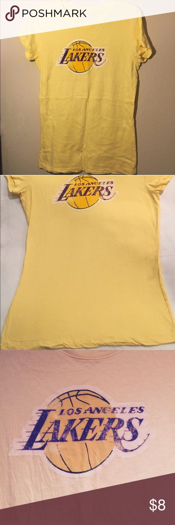 "Women's: Los Angeles Lakers t-shirt Yellow L.A. Lakers t-shirt. Lettering is NOT faded/smeared. This is how the shirt was made. My ex is a season ticket holder and he bought this for me before we went to a game. I only wore it that night for a few hrs, washed it and it's been hanging in my closet since. 17"" from Armpit to Armpit. **NOTE: color is more the 1st/2nd pic  Ask any questions before purchasing!! 💝  🚭 Smoke Free House 🐶 Pet Free House ✅ Bundle Discount 👎 Low Ball Offers 🚫 No…"