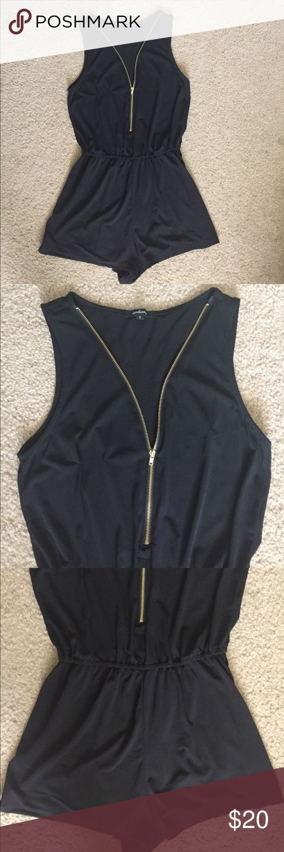 Black zip up romper Gently used. In good condition! Has a gold zipper in front. Size Small. Material is 95% Polyester and 5% Spandex. Ambiance Apparel Dresses