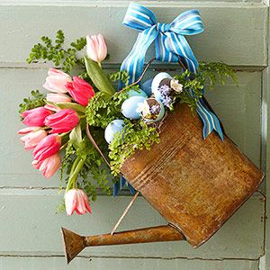 Vintage Watering Can ~ set floral foam in the can to secure the stems. Fill in with spring accents, then wire to door