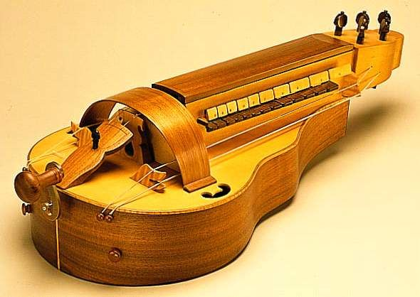Hurdy Gurdy -  The hurdy gurdy or hurdy-gurdy is a stringed musical instrument that produces sound by a crank-turned rosined wheel rubbing against the strings. The wheel functions much like a violin bow, and single notes played on the instrument sound similar to a violin. Melodies are played on a keyboard that presses tangents (small wedges, typically made of wood) against one or more of the strings to change their pitch. Like most other acoustic stringed instruments, it has a sound board to…