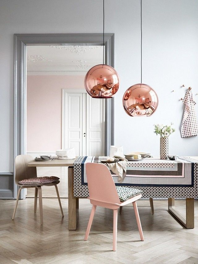 Scandinavian inspired dinning space with pastel hues, rose gold pendant lights, and modern chairs
