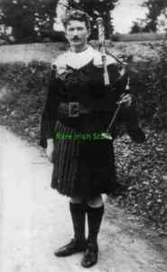 Thomas Ashe (12th January 1885 - 25 September 1917).     He is dressed here in a kilt and is also holding a set of bagpipes.        Ashe was a member of the Irish Republican Brotherhood (IRB), the Gaelic League and a founding member of the Irish Volunteers.