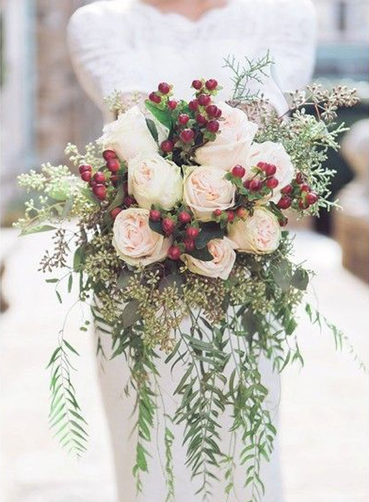 A splash of red makes this bouquet stand out amidst the sea of white. You could use winterberries, holly berries or cranberries. If blue is your wedding color of choice, go for juniper berries instead. A little bit goes a long way with these. Pepper them in among the white roses or baby's breath. | Winter Berry Bouquet | Seasonal Favorites: 5 Winter Wedding Bouquets