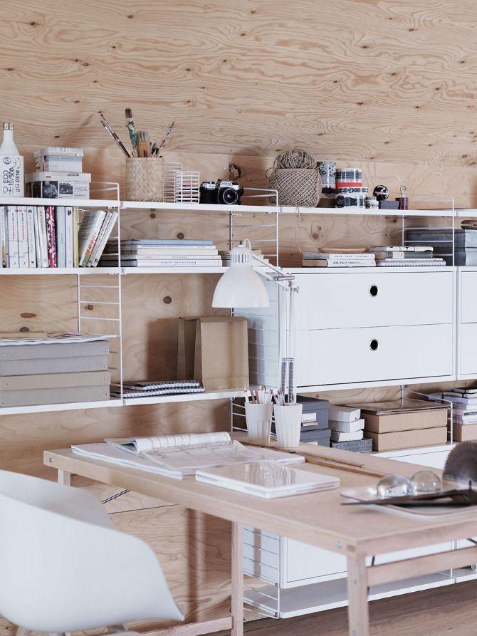 white shelving against a wooden wall - fabulous idea so it's not so sanitary feeling