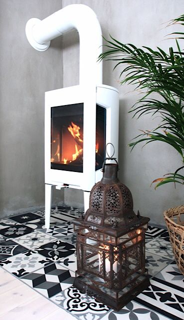 Woodstove from Jøtul, tiles from Zoco Home and lantern from Tine K Home✨