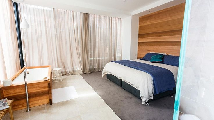 recessed ceiling, ceiling to floor curtains, headboard feature
