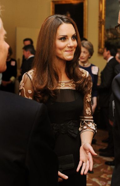 Catherine, Duchess of Cambridge smiles as she talks to athletes during a reception held for Team GB Olympic and Paralympic London 2012 medalists at Buckingham Palace on October 23, 2012 in London, England.