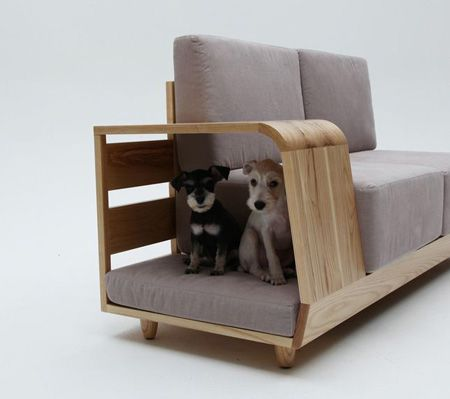 Designer Dog House  Owners can interact with their pets through the opening under the armrest without relinquishing prime sofa space, or encouraging the dog to jump up on the furniture.