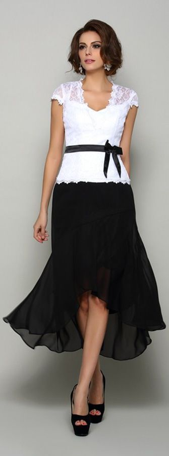 Chic black and white lace cap sleeved mother of the bride dress with a sash. Nice for summer weddings