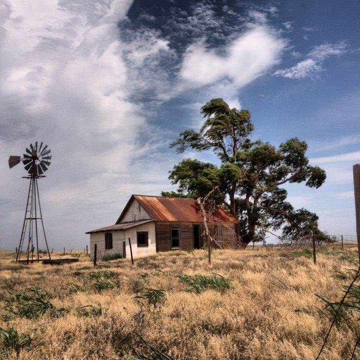 Abandoned house and windmill on the prairie in western Oklahoma