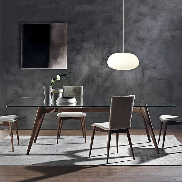 Designed by architect Fabio Rebosio for luxury Italian maker Pacini e Cappellini, the Novecento dining table is a modern, elegant design in solid ash and glass.