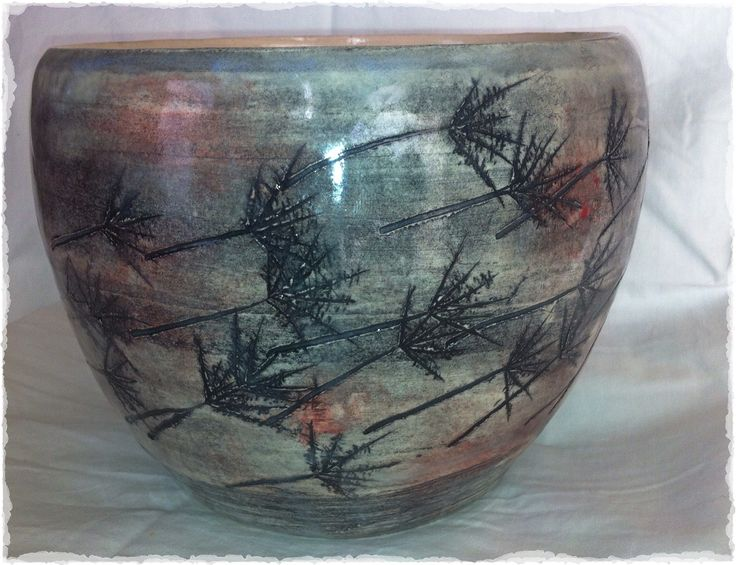 Hand thrown bowl with etching, oxide & underglaze