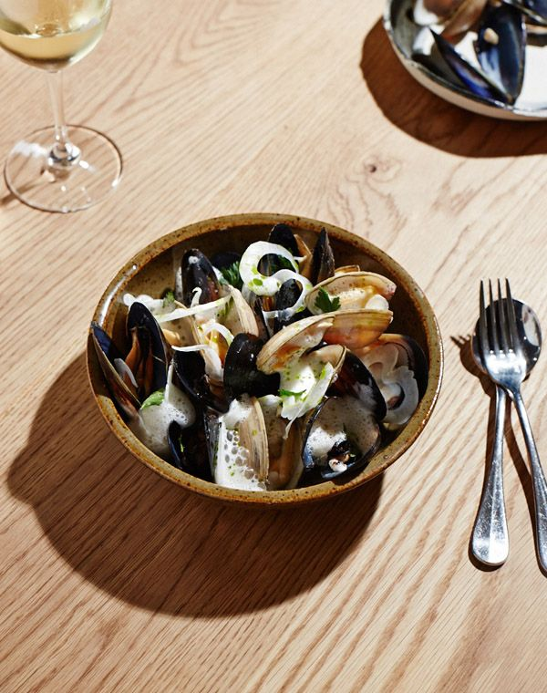 Steamed diamond shell clams & black mussels with clam bisque, fennel and rosemary oil