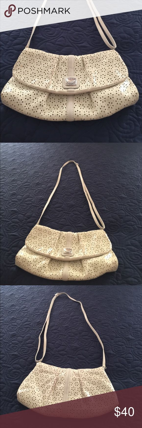 Brighton cross body cream color Dooney & Bourke cross body - can also be used as a wristlet. Cream color with black and white interior pattern.  Used a dozen times, non smoker.  Small discoloration on back side of purse Brighton Bags Crossbody Bags