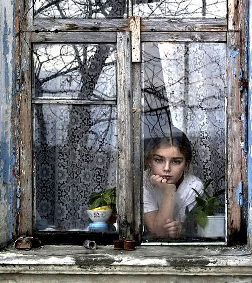 A child looking out a window.