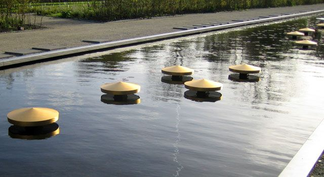 Product: Urns   Design: Tjalling Wolthuis    Like a golden ribbon from the golden urns form a beautiful display in the new eastern pond.   The urns flow just above the water which causes a beautiful picture.