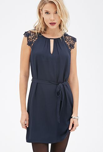 Crochet-Sleeved Dress: Subtle Pintucking at its vented round neckline and floral crochet cutout cap sleeves.
