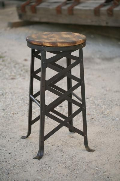 Classic industrial design. Riveted steel construction and torch-burnt hardwood seat.