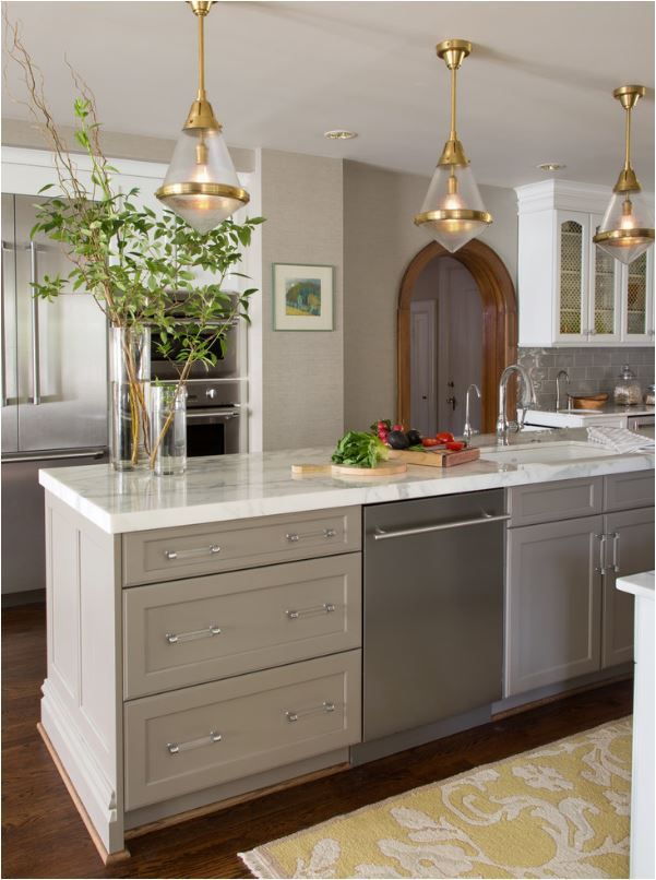 Taupe Kitchen Cabinets- love the Lucite drawer pulls and the white, square-edged stone countertop