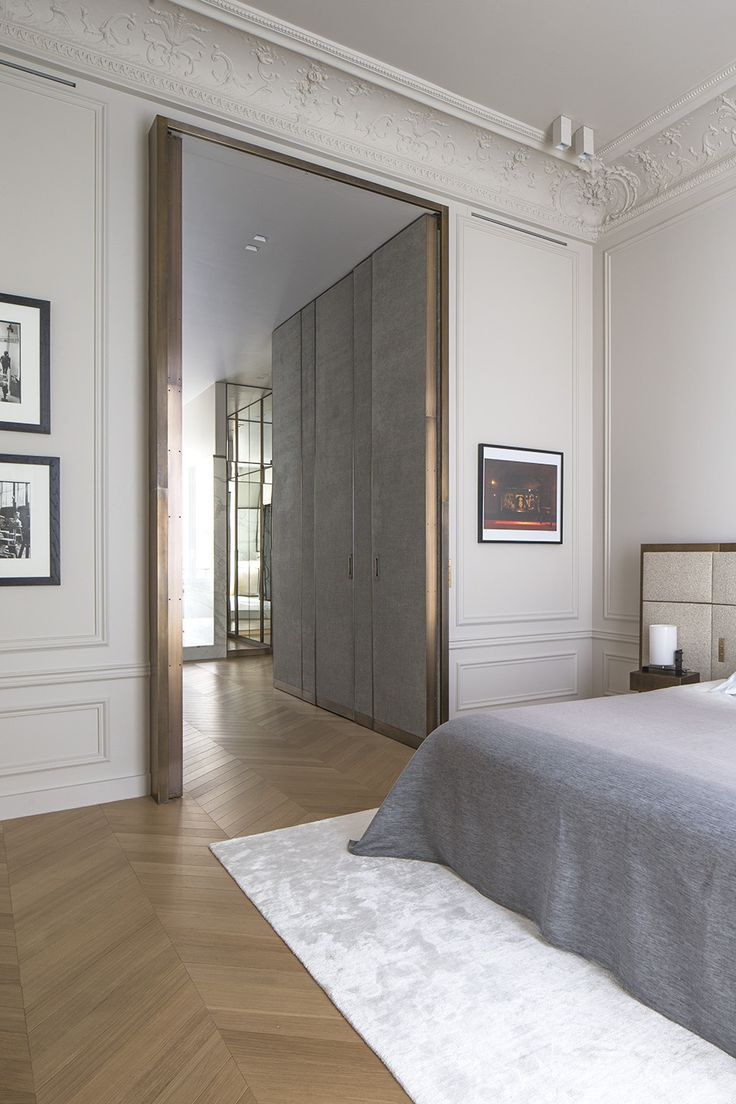 Private appartment in Paris, fitting room and bedroom with a giant brass door, interior design by Rodolphe Parente