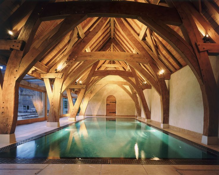 A stunning cruck frame houses this swimming pool for Cruck frame house plans