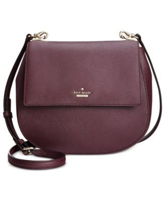 "Embrace curve appeal with kate spade new york's rounded crossbody, designed with minimalist style for effortless day-to-night appeal. | Leather; lining: polyester | Imported | 8-9/10""W x 8""H x 3-1/5""D"