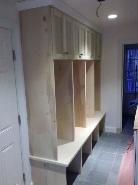 Mudroom Lockers-love this. Open to the floor, crown moulding and cabinets at the top, and the deep bench.