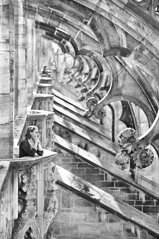 Il Duomo di Milano - lovely detailed Black and white artist sketch woman leaning on her elbows at a high balcony, near the buttresses: Mary Ann Smale's pin. via DdO:) http://www.pinterest.com/DianaDeeOsborne/intriguing-architecture