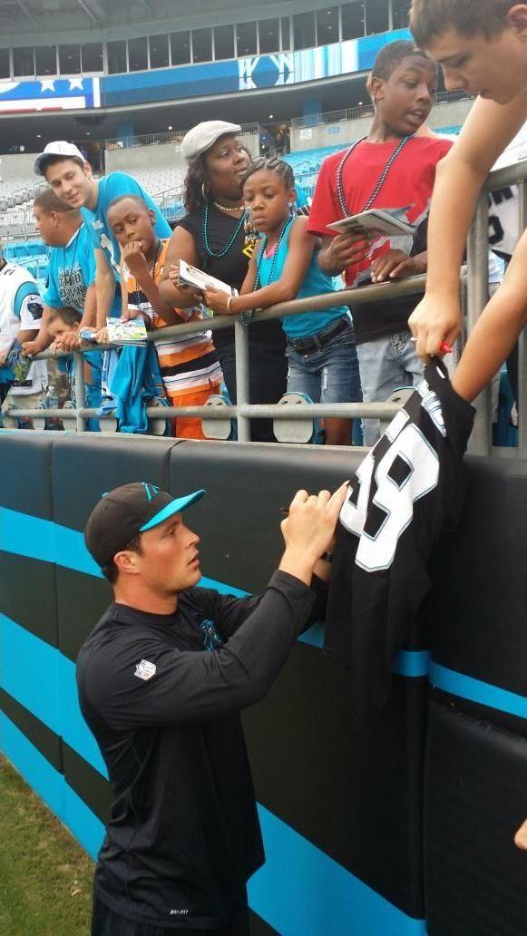 Luke Kuechly always a fan favorite on the sidelines