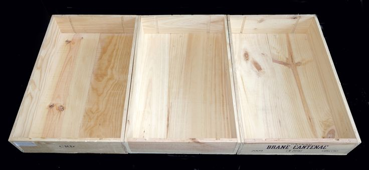 The inside of 3 flat wooden wine cases